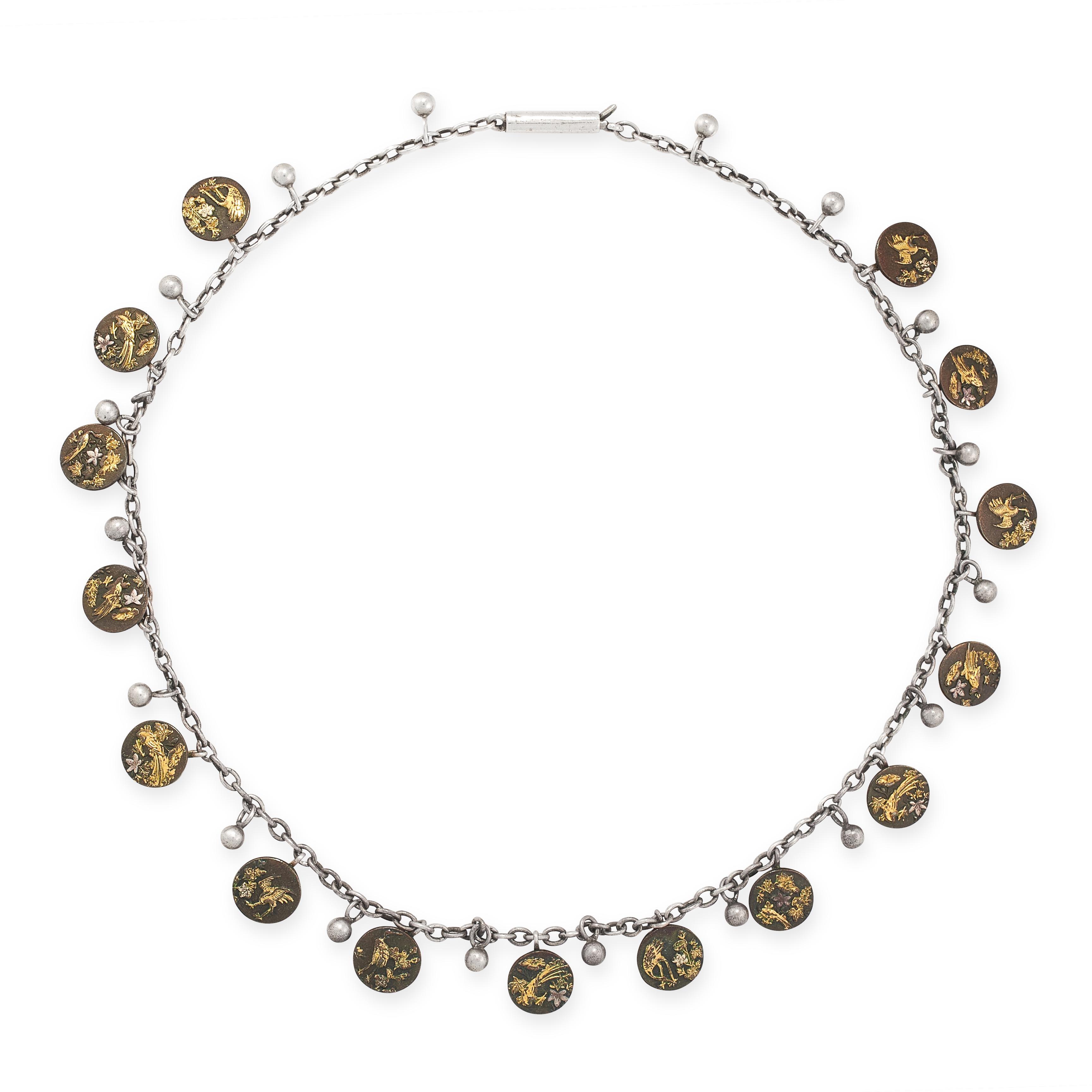 AN ANTIQUE JAPANESE SHAKUDO NECKLACE suspending fifteen circular pendants / charms with shakudo