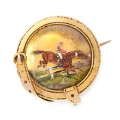 AN ANTIQUE REVERSE INTAGLIO CRYSTAL STEEPLECHASE BROOCH, 19TH CENTURY in yellow gold, set with a