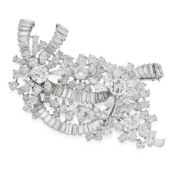 A VINTAGE DIAMOND EN TREMBLANT BROOCH designed as a series of ribbon and flower motifs jewelled with