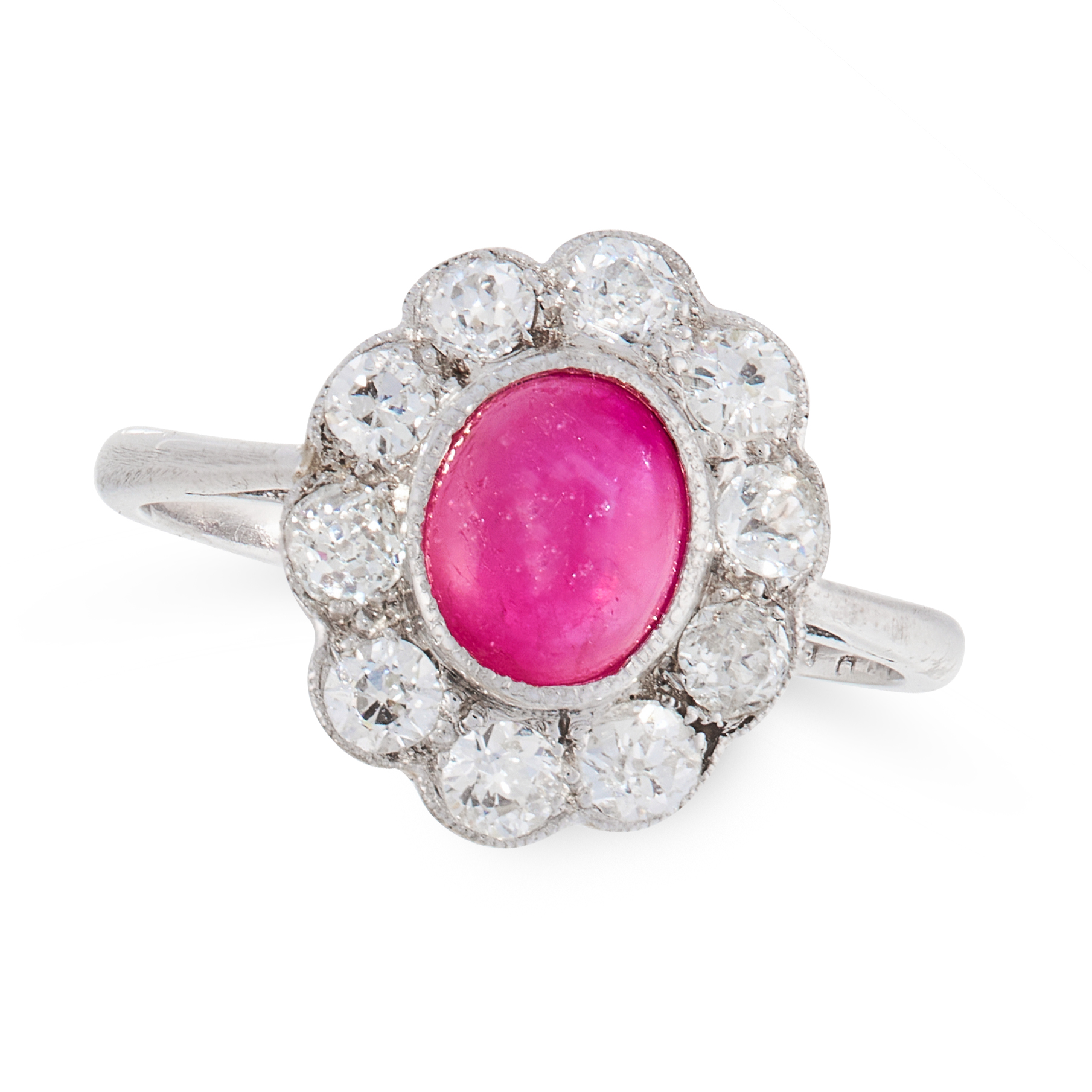 A VINTAGE RUBY AND DIAMOND DRESS RING in 18ct white gold, set with an oval cabochon ruby of 1.50