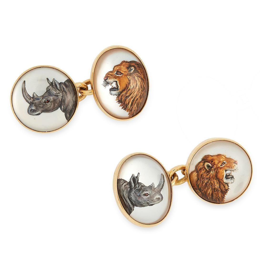 A PAIR OF REVERSE INTAGLIO AFRICAN SAFARI ANIMAL CUFFLINKS, DEAKIN & FRANCIS in 18ct yellow gold,