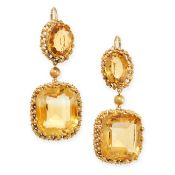 A PAIR OF ANTIQUE CITRINE EARRINGS in yellow gold, each set with a cushion cut and oval cut citrine,