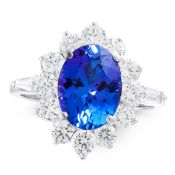 A TANZANITE AND DIAMOND DRESS RING in 18ct white gold, set with an oval cut tanzanite of 3.66