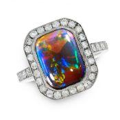 A BLACK OPAL AND DIAMOND DRESS RING set with a cushion shaped cabochon black opal of 3.16 carats,