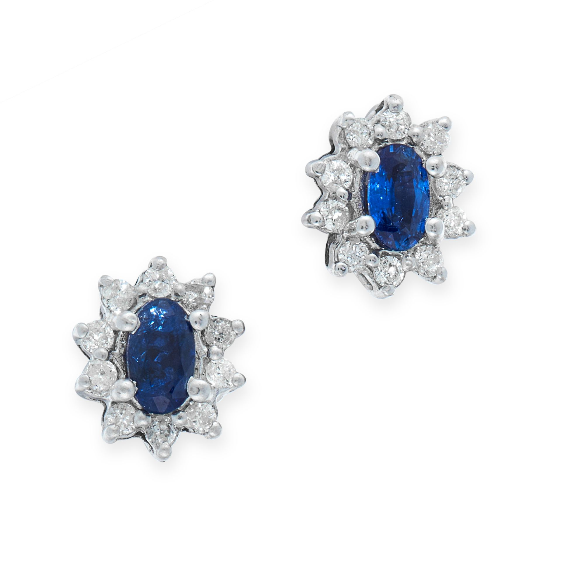 A PAIR OF SAPPHIRE AND DIAMOND STUD EARRINGS in 18ct white gold, each set with an oval cut blue