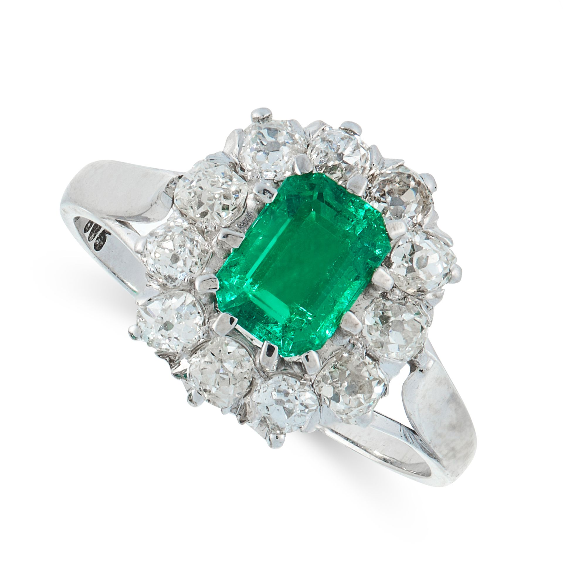 A COLOMBIAN EMERALD AND DIAMOND DRESS RING in 14ct white gold, set with an emerald cut emerald of