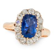 A BURMA NO HEAT SAPPHIRE AND DIAMOND CLUSTER RING in yellow gold, set with a cushion cut sapphire of