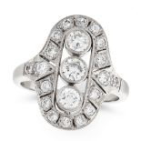 A VINTAGE DIAMOND DRESS RING the face set with a trio of principal round cut diamonds, within a