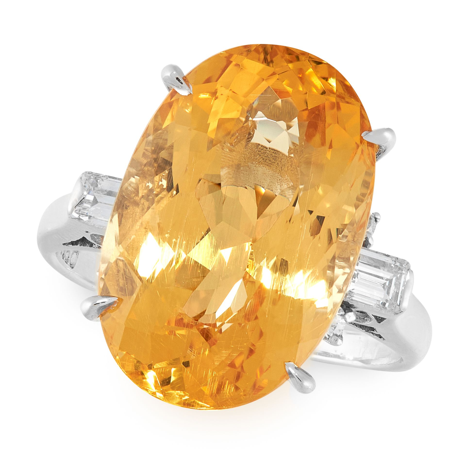 A HELIODOR AND DIAMOND RING in platinum, set with an oval cut heliodor (golden beryl) of 10.08