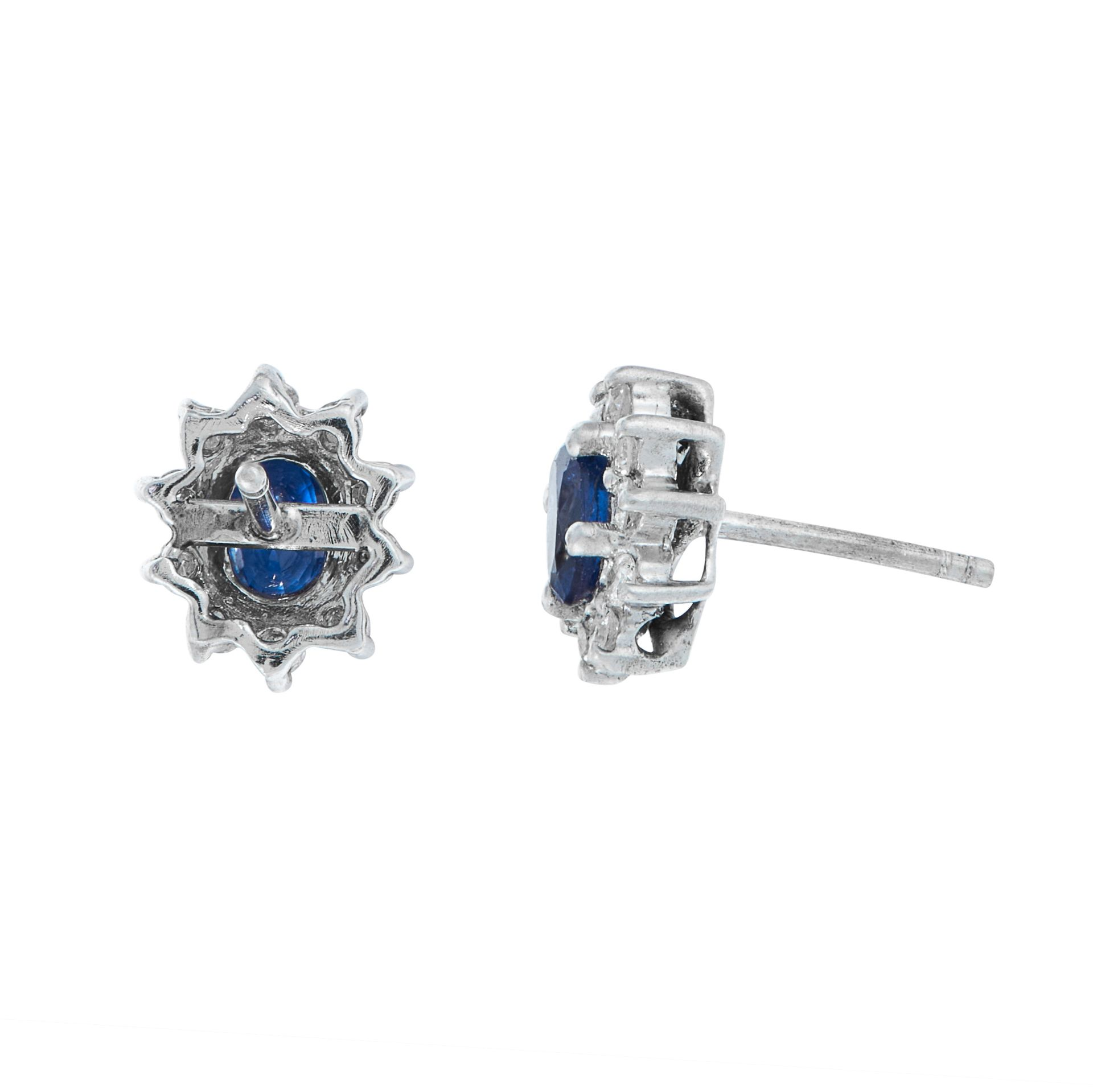 A PAIR OF SAPPHIRE AND DIAMOND STUD EARRINGS in 18ct white gold, each set with an oval cut blue - Image 2 of 2