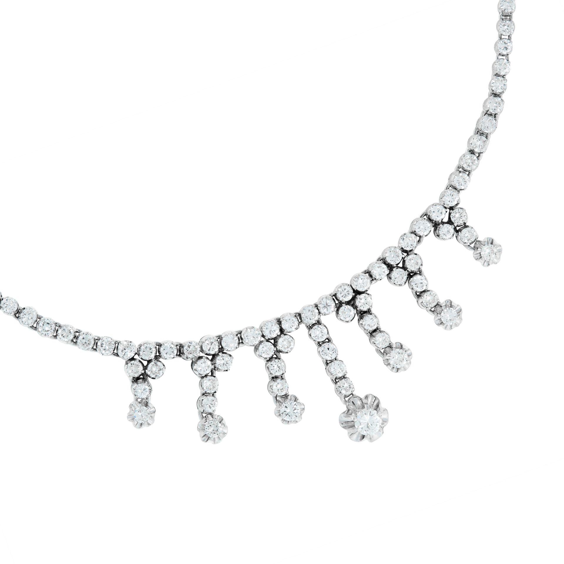 A DIAMOND FRINGE NECKLACE comprising a single row of graduated round cut diamonds, suspending