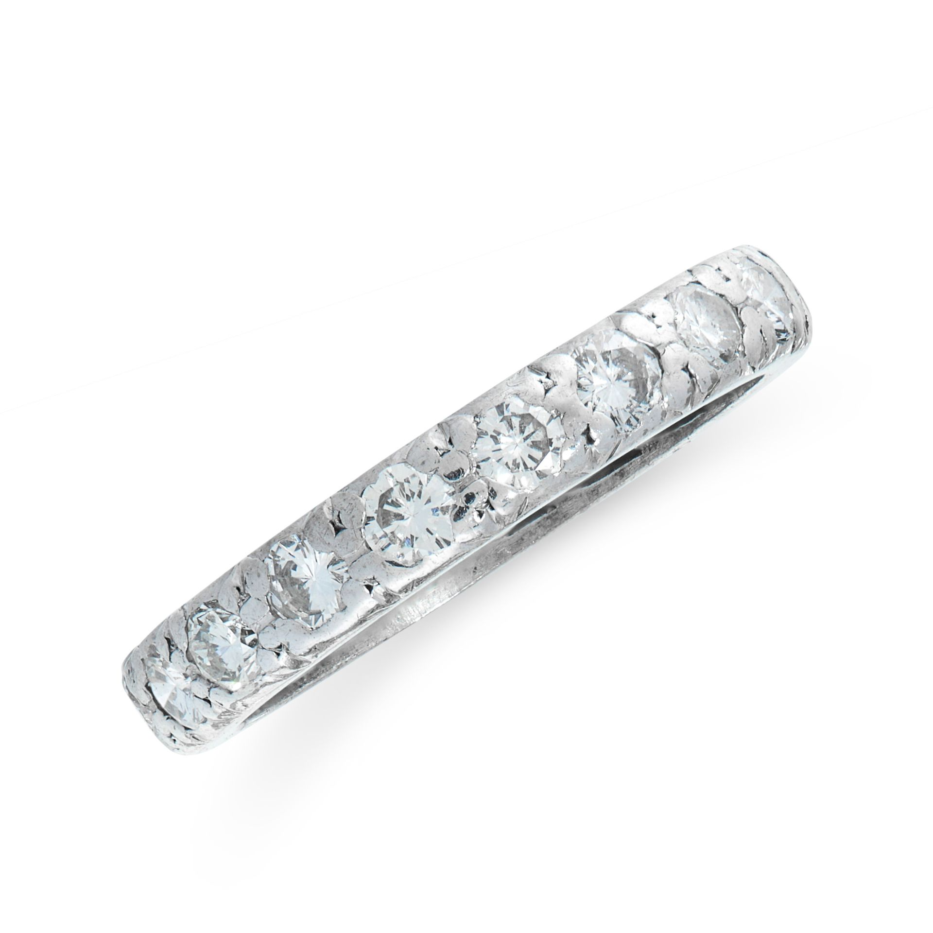 A DIAMOND ETERNITY RING the band set all around with a single row of round cut diamonds, all
