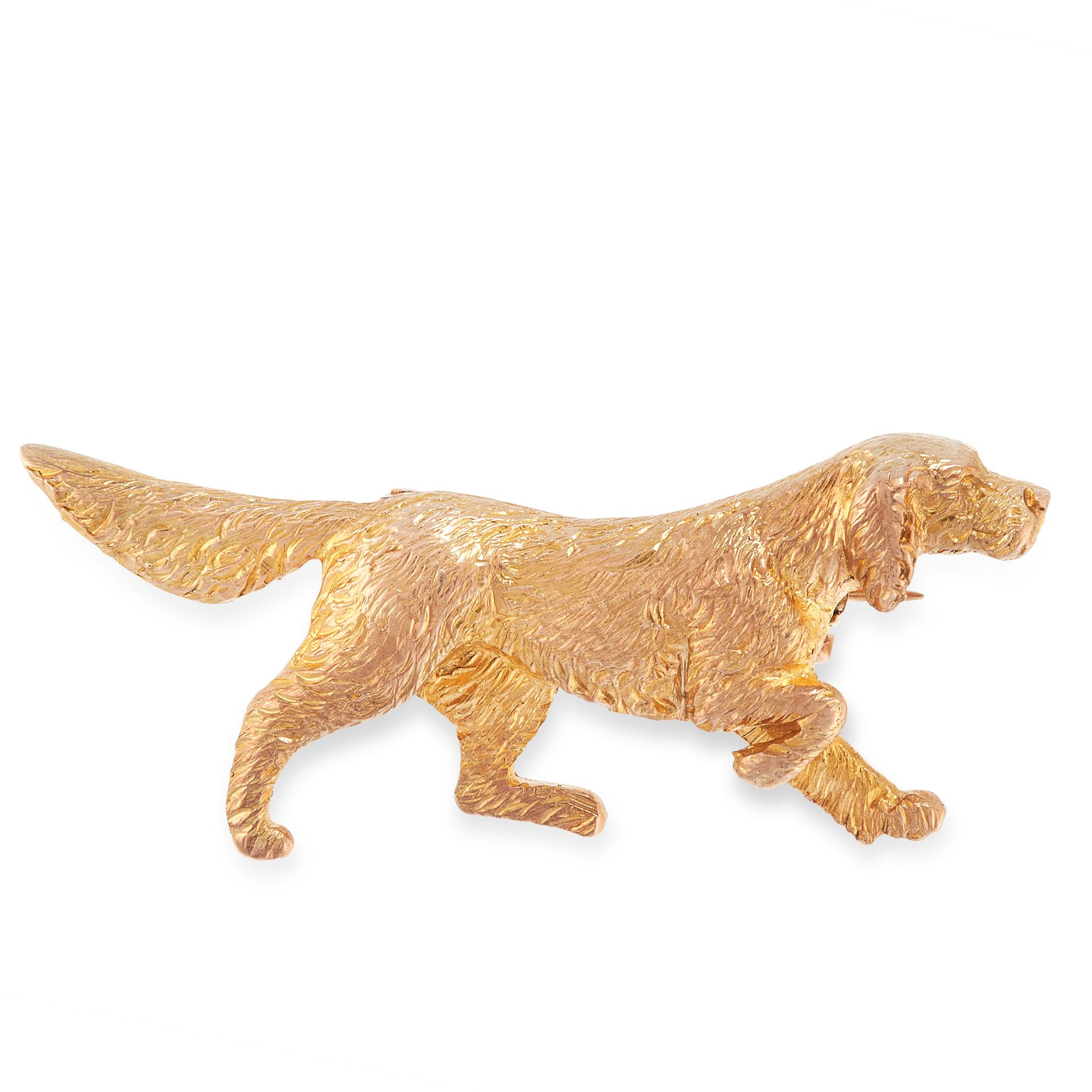 A VINTAGE DOG BROOCH in yellow gold, in the form of an English Setter or other hunting hound,