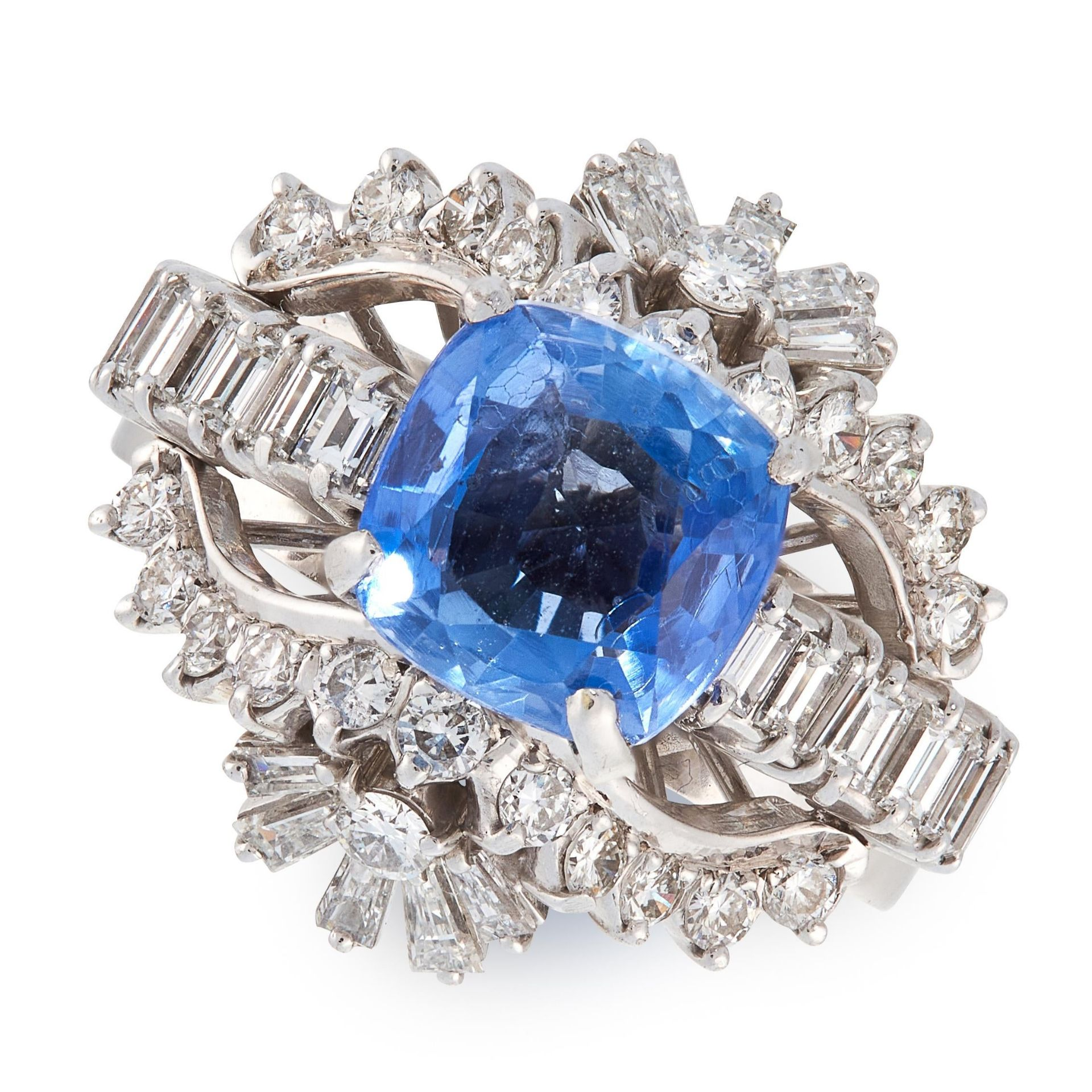 A SAPPHIRE AND DIAMOND DRESS RING, MANNING in 14ct white gold, set with a cushion cut blue