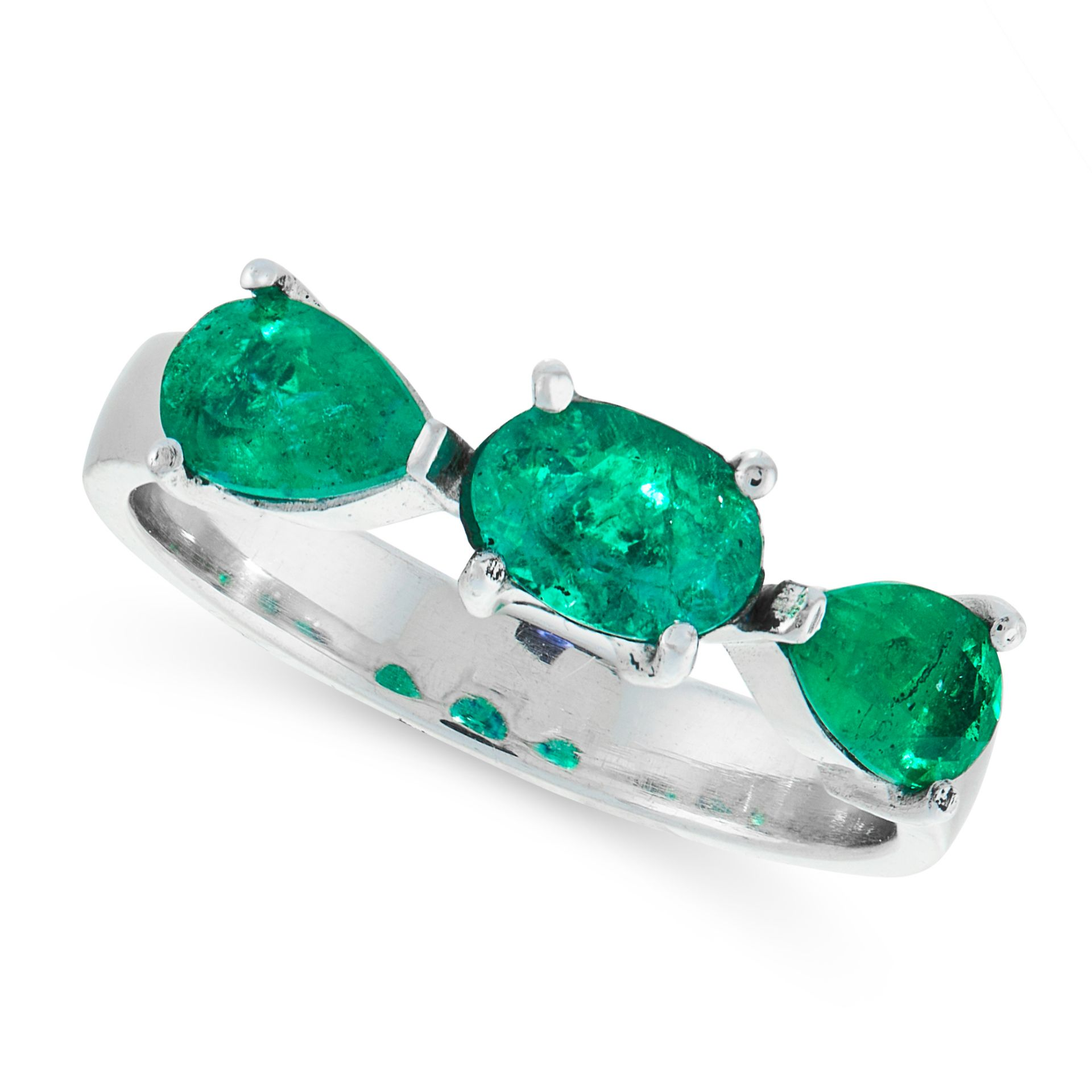 AN EMERALD DRESS RING in 18ct white gold, set with a trio of oval cut and pear cut emeralds, stamped