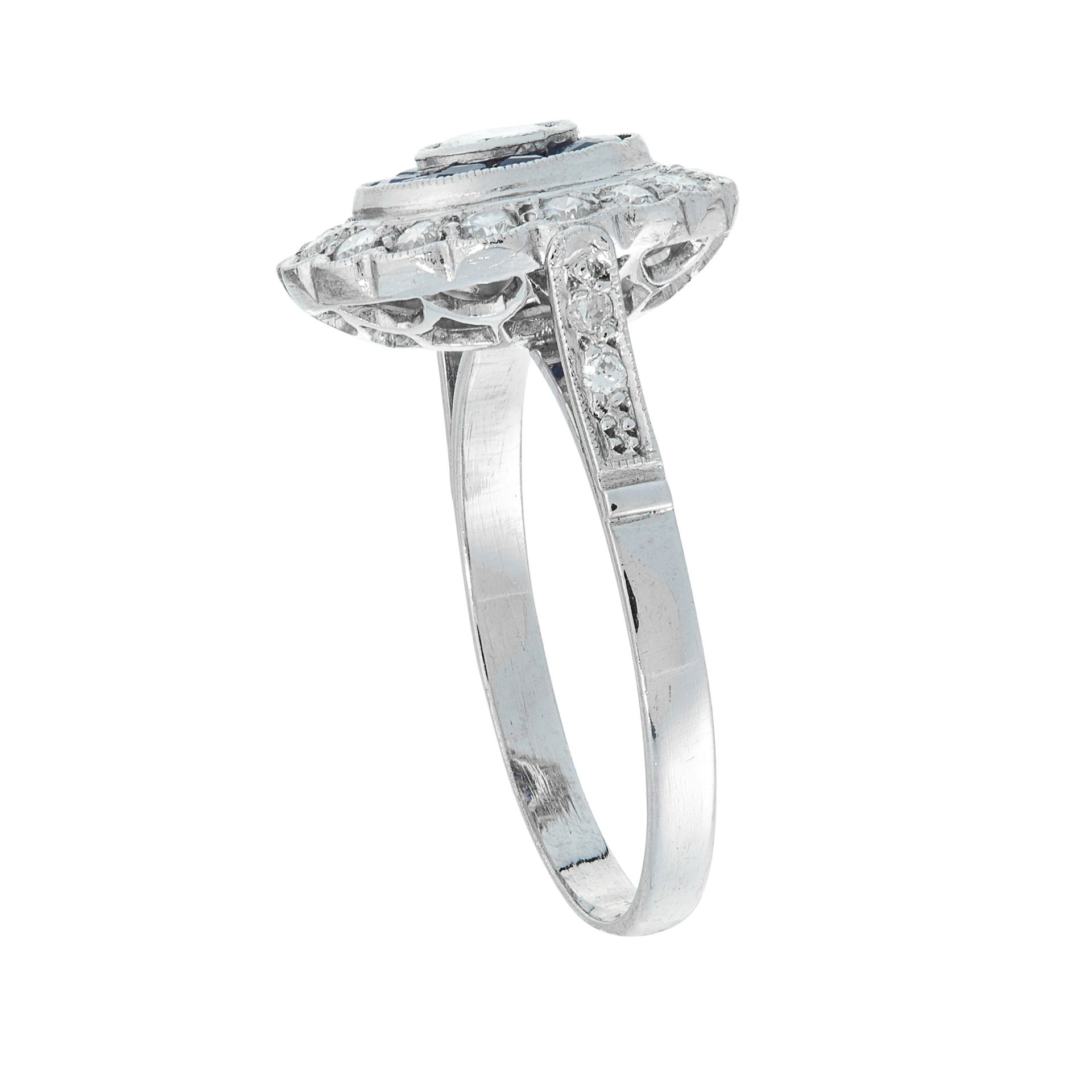 A DIAMOND AND SAPPHIRE DRESS RING of target design, the central round cut diamond within - Image 2 of 2