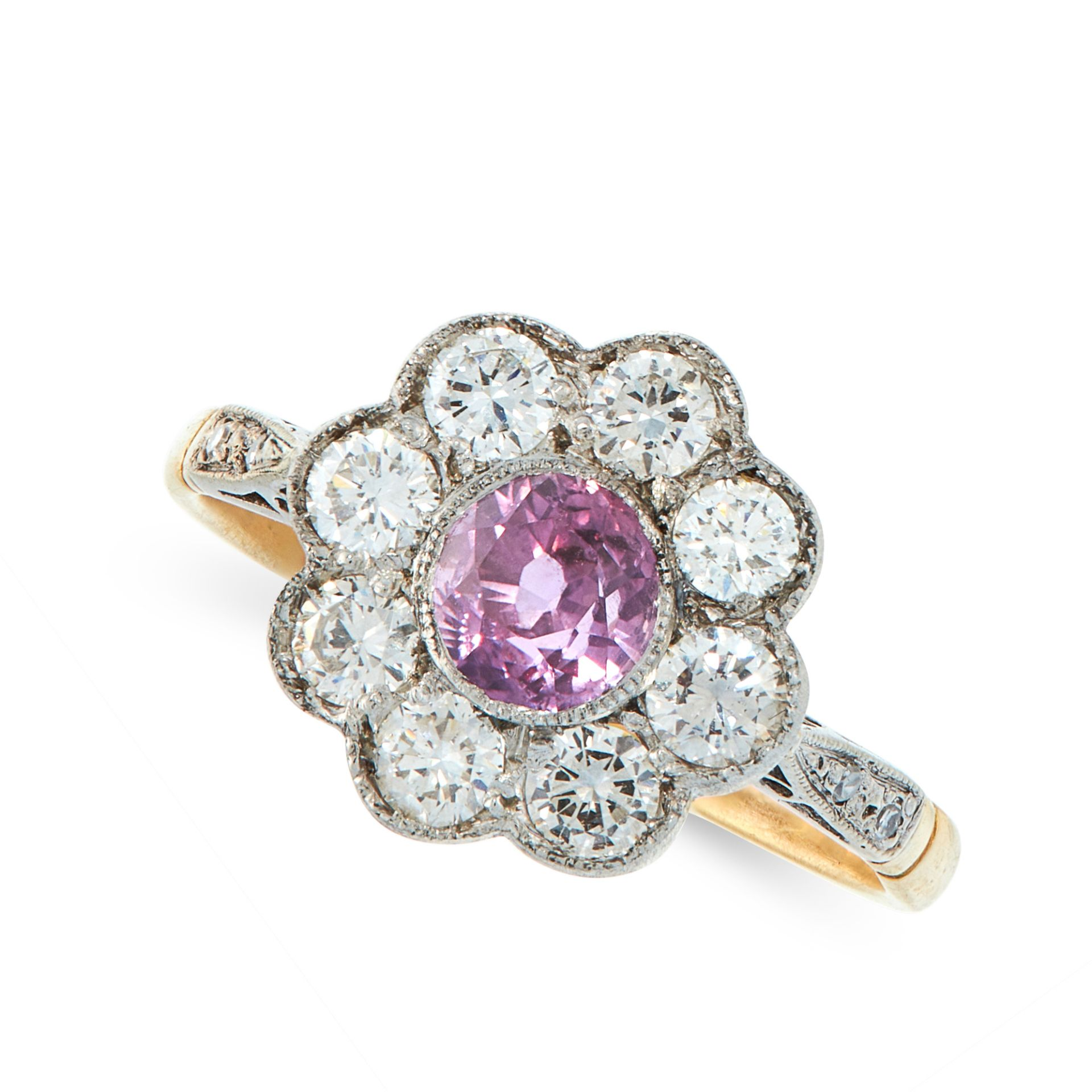 A PINK SAPPHIRE AND DIAMOND DRESS RING in 18ct yellow gold, set with a round cut pink sapphire of