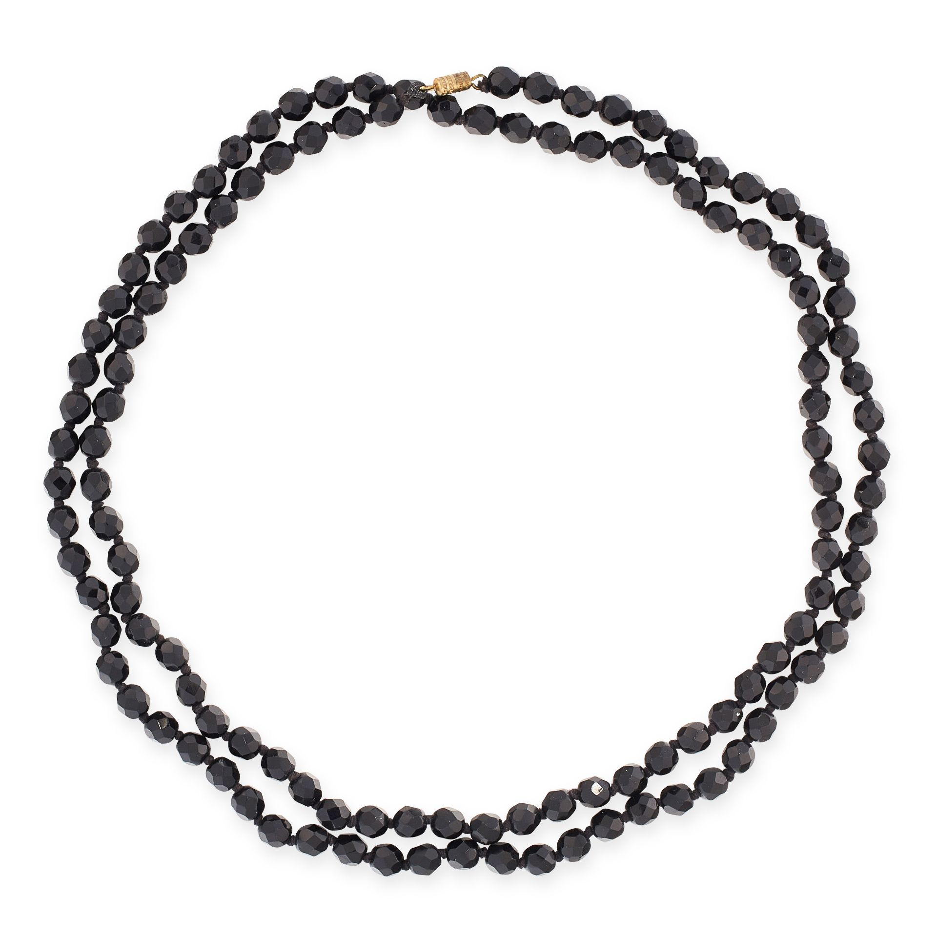 A VINTAGE BEAD NECKLACE comprising a single row of faceted black beads, 104.0cm, 52.8g.