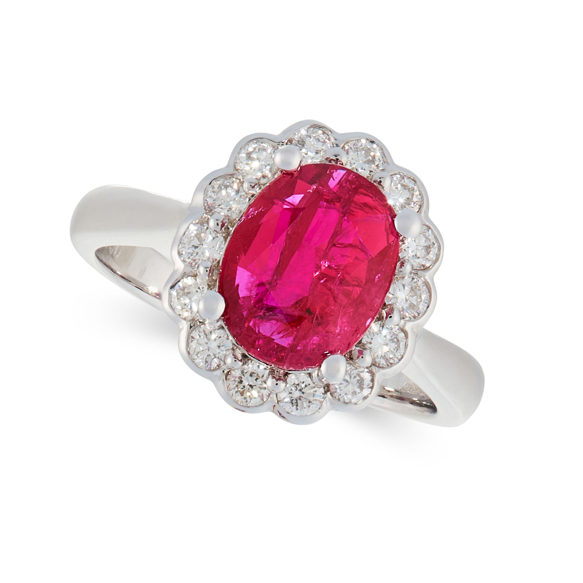 AN UNHEATED RUBY AND DIAMOND CLUSTER RING in 18ct white gold, set with an oval cut ruby of 2.17