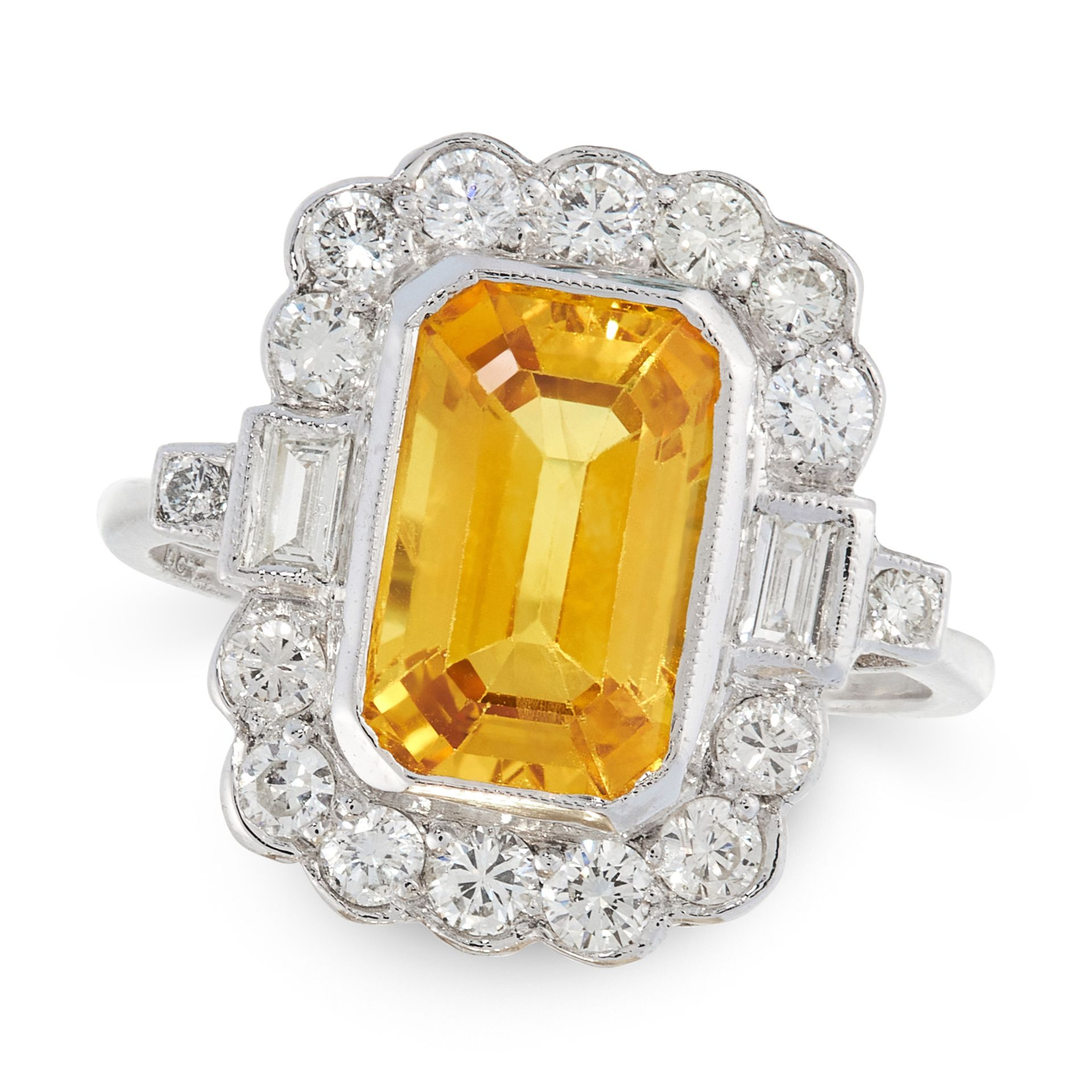 A VINTAGE YELLOW SAPPHIRE AND DIAMOND DRESS RING in 18ct white gold, set with an emerald cut