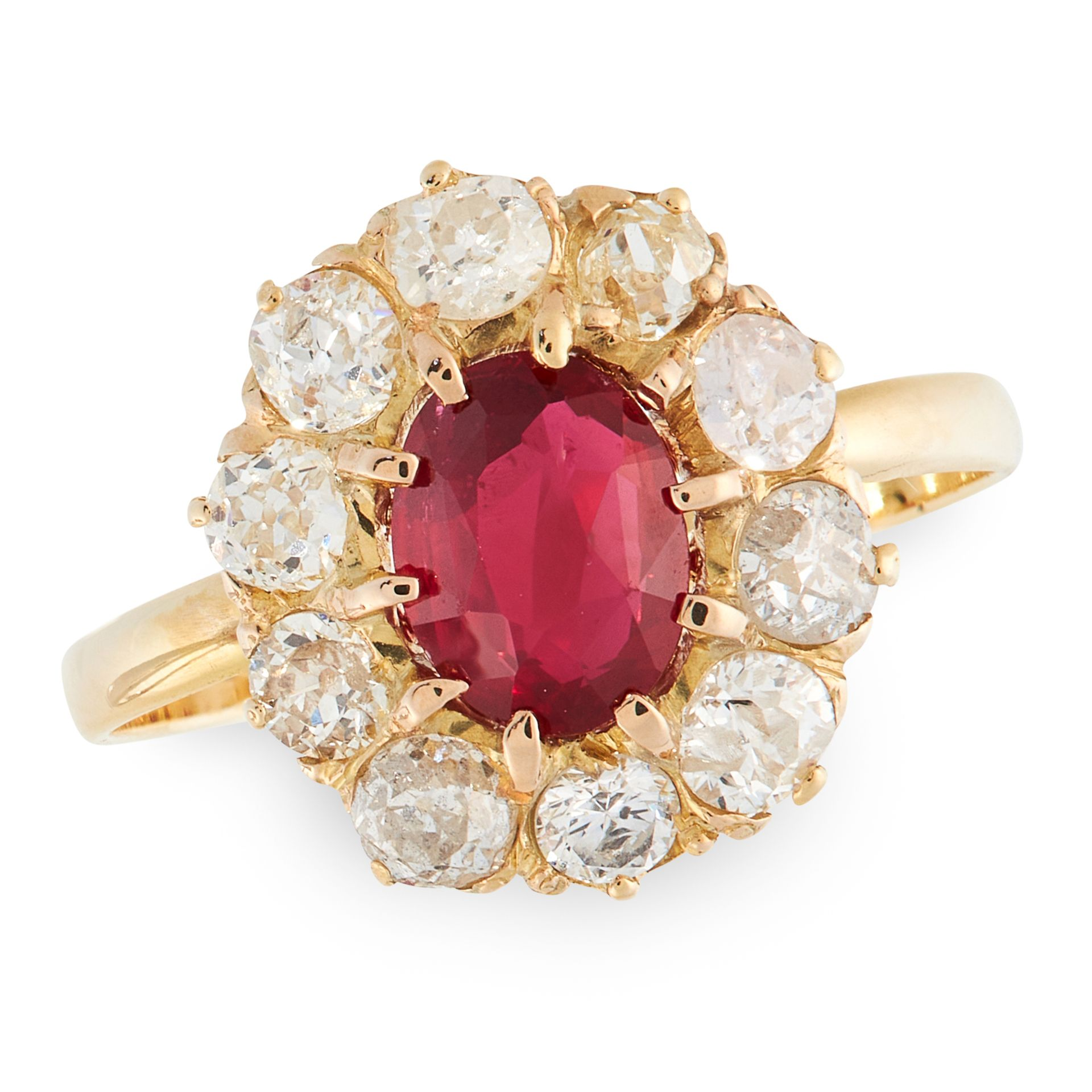 A RUBY AND DIAMOND CLUSTER RING in yellow gold, set with an oval cut ruby of 0.84 carats in a border