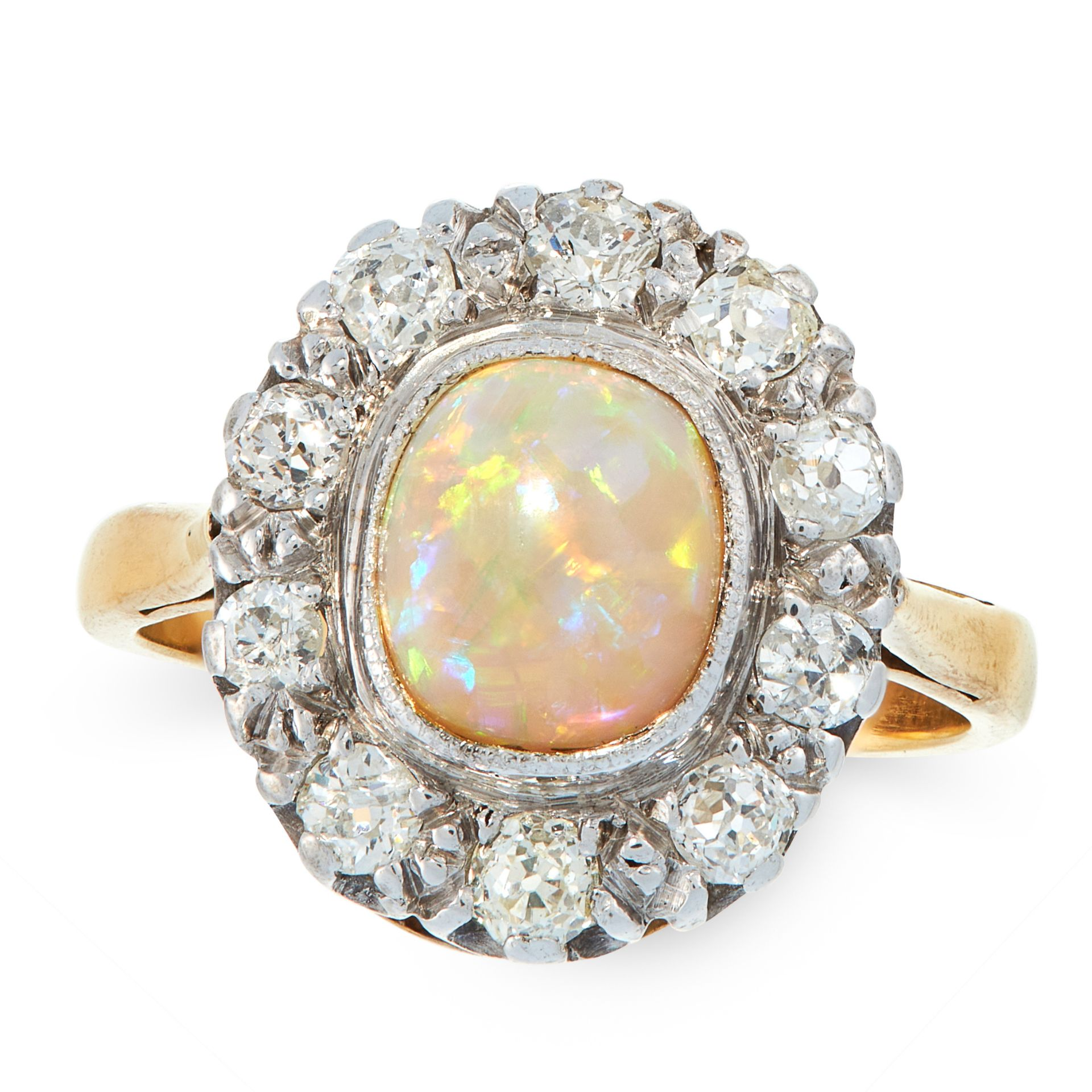 AN OPAL AND DIAMOND DRESS RING in high carat yellow gold, set with an oval cabochon opal of 1.11