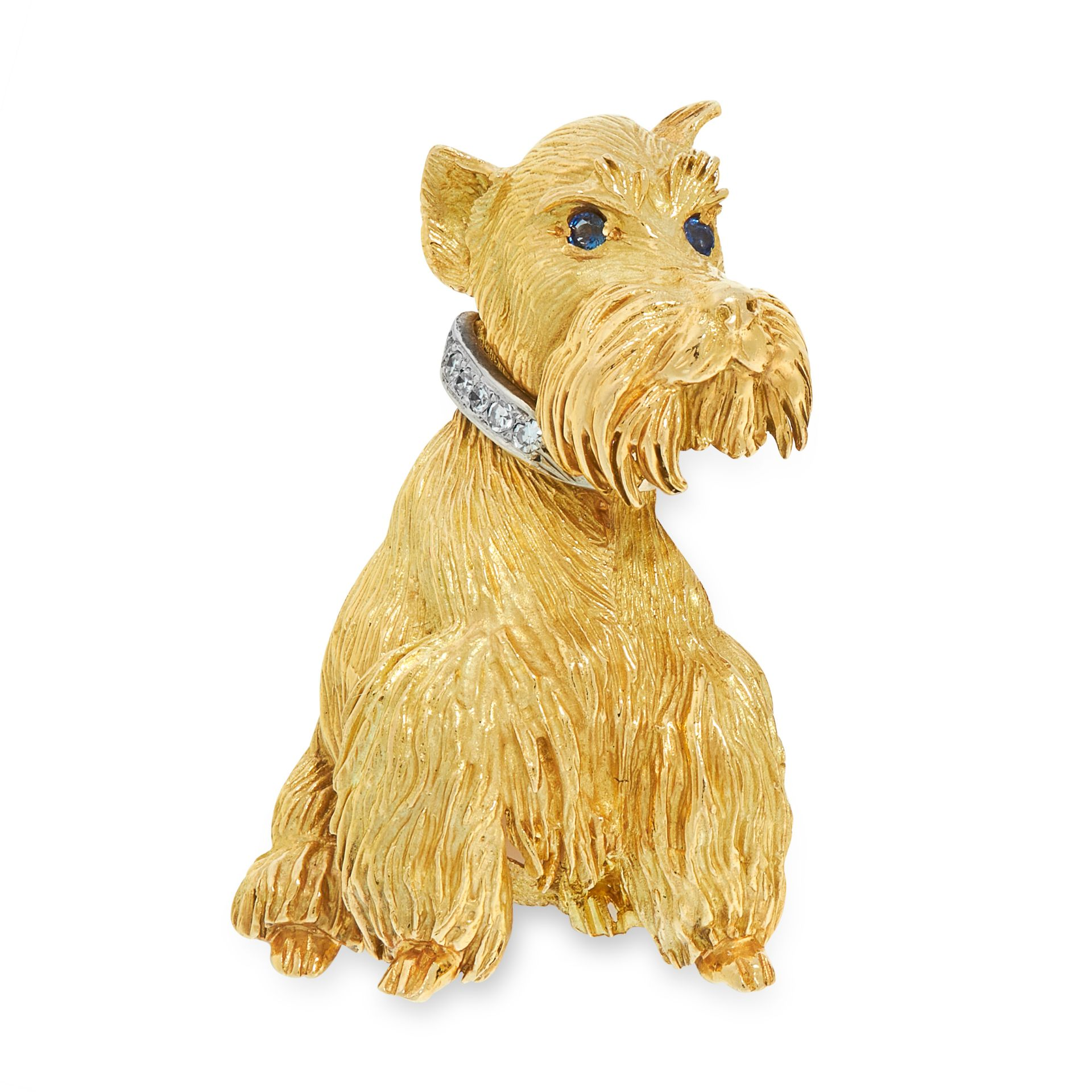 A SAPPHIRE AND DIAMOND DOG BROOCH signed Cartier, in 18ct yellow gold, in the form of a Scottie dog,