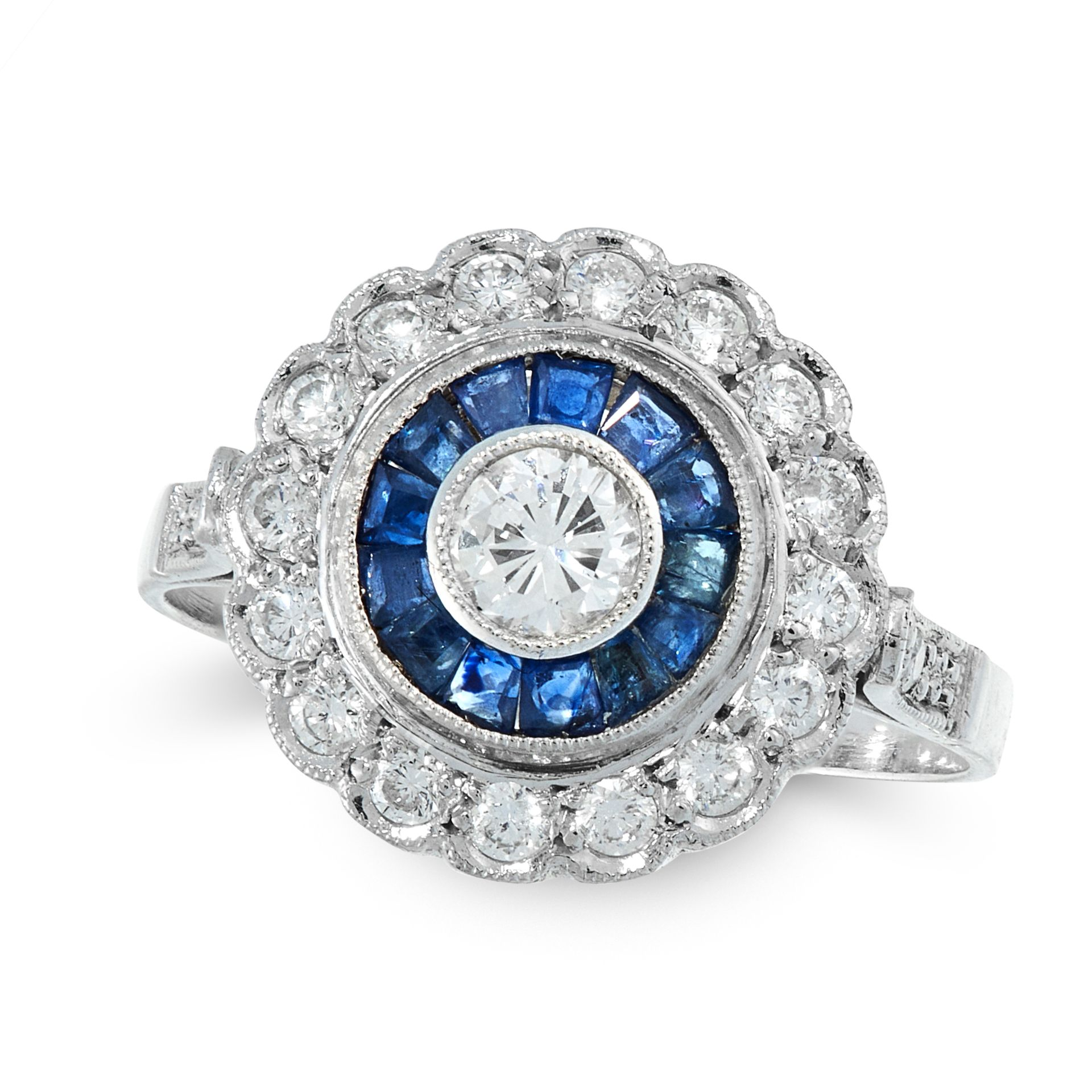 A DIAMOND AND SAPPHIRE DRESS RING of target design, the central round cut diamond within