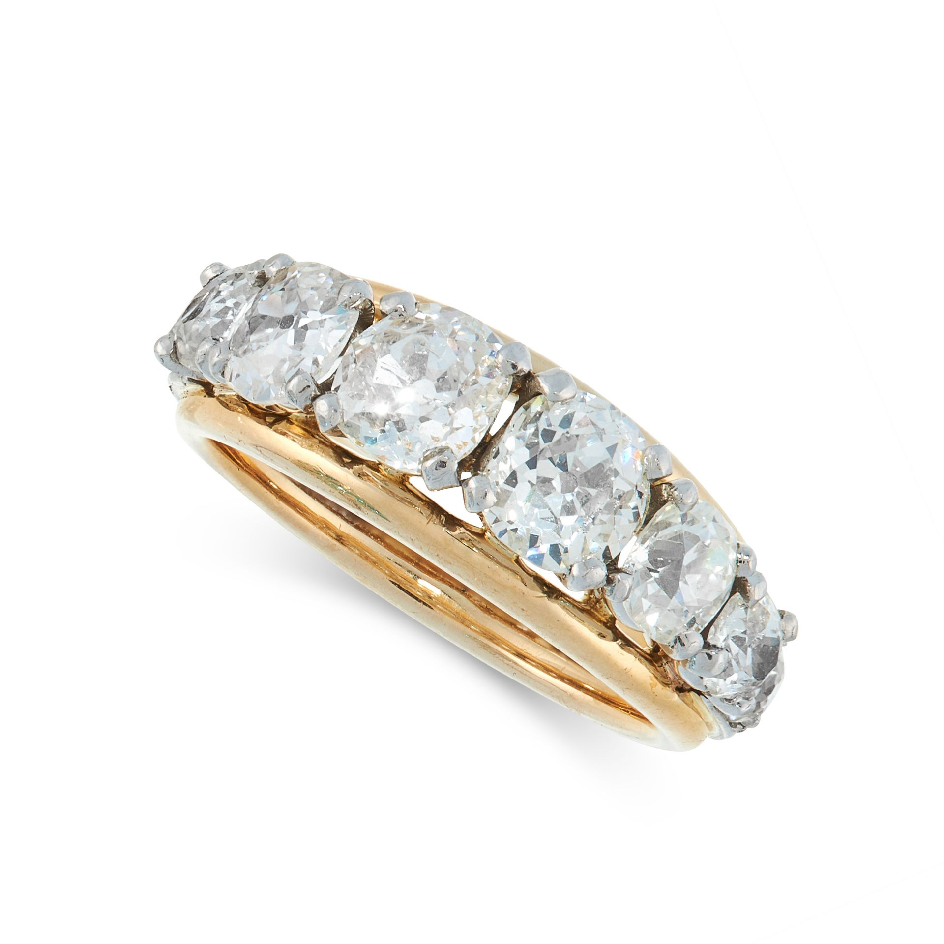 A DIAMOND DRESS RING in yellow and white gold, the tapering band set with twelve graduated old cut