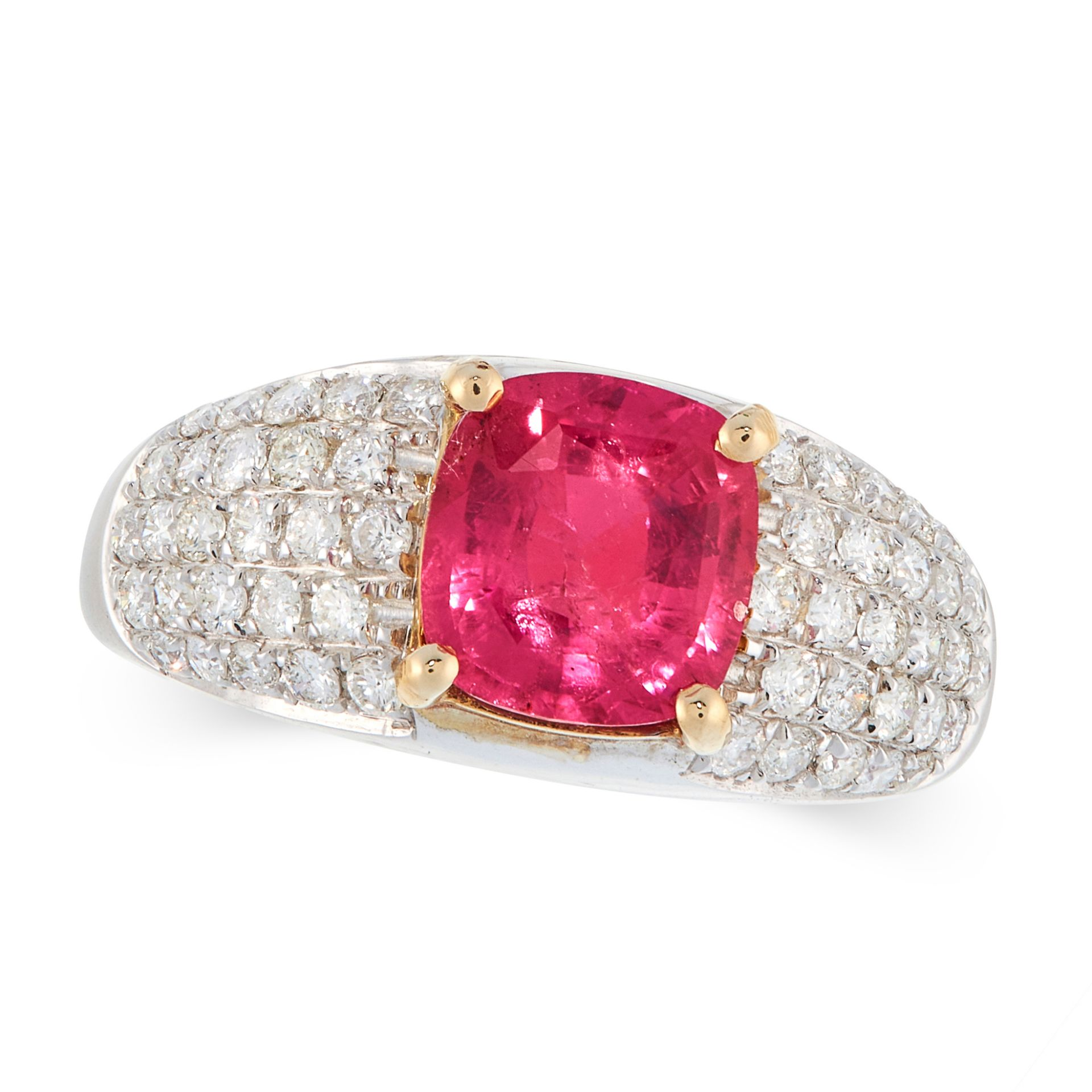 AN UNHEATED RUBY AND DIAMOND DRESS RING in 18ct white and yellow gold, set with a cushion cut ruby