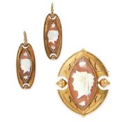AN ANTIQUE CAMEO BROOCH AND EARRINGS SUITE in yellow gold, each set with a navette shaped carved