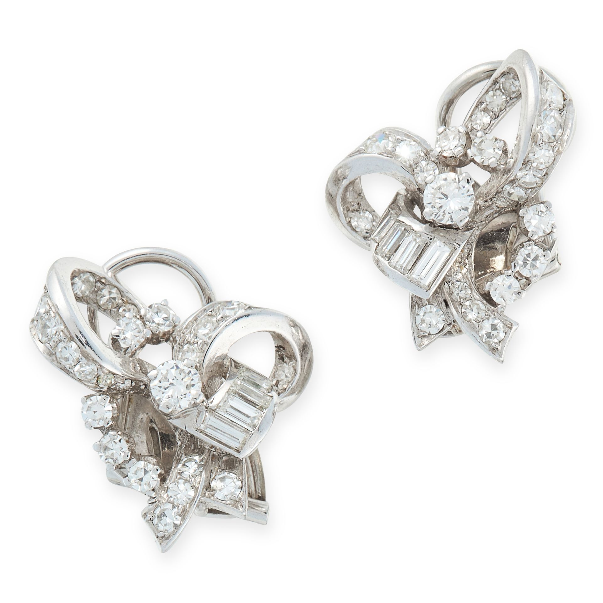 A PAIR OF VINTAGE DIAMOND CLIP EARRINGS in 18ct white gold, each deigned as a ribbon tied in a
