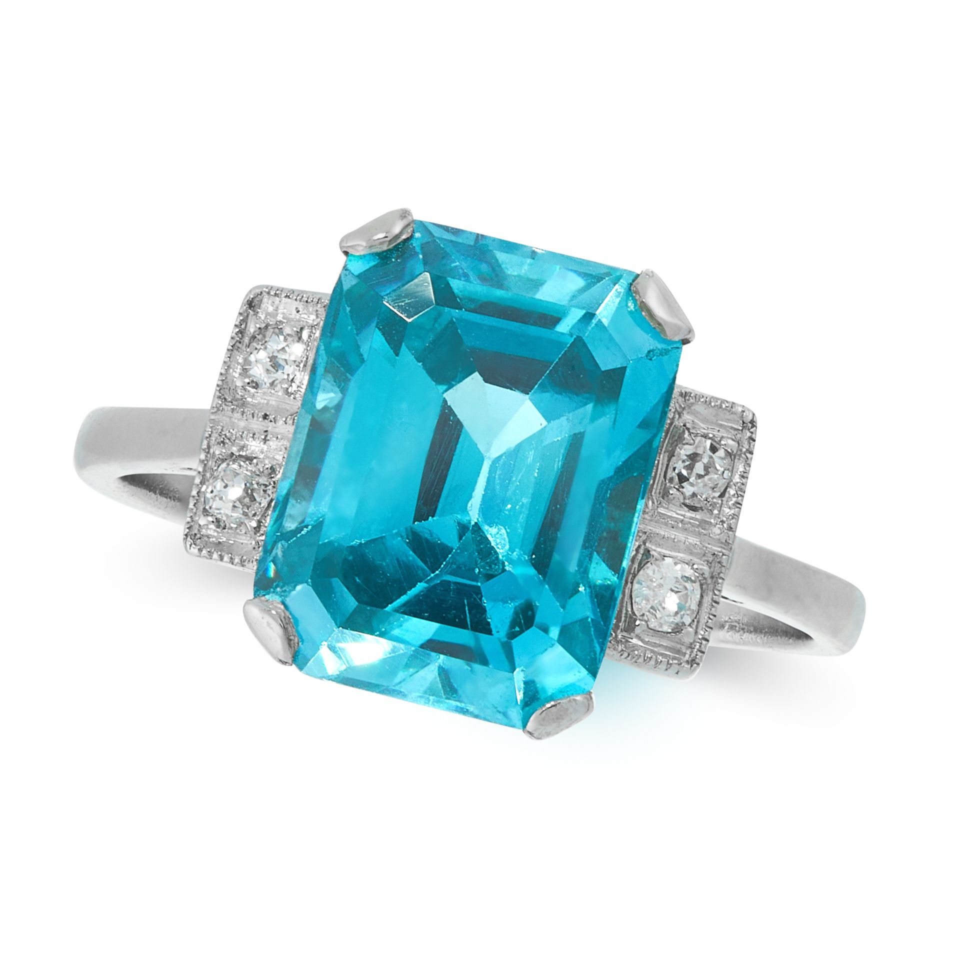 A BLUE ZIRCON AND DIAMOND DRESS RING, EARLY 20TH CENTURY in platinum, set with an emerald cut blue