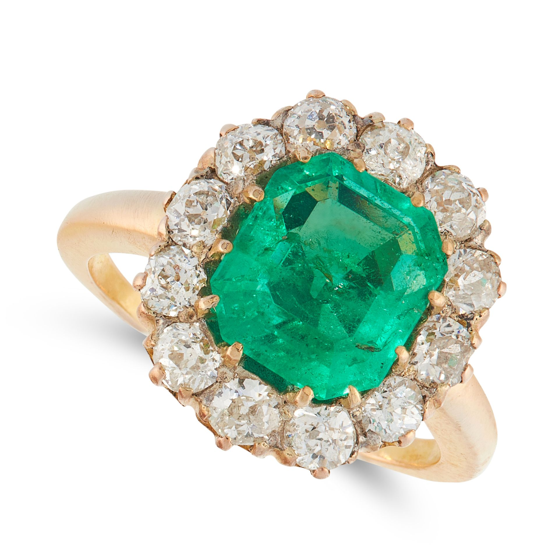 A COLOMBIAN EMERALD AND DIAMOND RING, EARLY 20TH CENTURY in 18ct yellow gold, set with an emerald