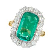 A FINE COLOMBIAN EMERALD AND DIAMOND DRESS RING in high carat yellow gold, set with a cushion cut