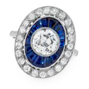 A DIAMOND AND SAPPHIRE DRESS RING in platinum, set with a central old cut diamond of 1.15 carats,