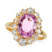 A PINK TOPAZ AND DIAMOND DRESS RING in 18ct yellow gold, set with an oval cut pink topaz of 2.75