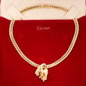 A PANTHERE NECKLACE, CARTIER in 18ct yellow gold, designed to depict a panther, draped over a