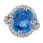 A SAPPHIRE AND DIAMOND RING, EARLY 20TH CENTURY in 18ct white gold, set with a cushion cut blue