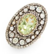 AN ANTIQUE CHRYSOBERYL AND DIAMOND COCKTAIL RING in yellow gold and silver, set with an oval cut