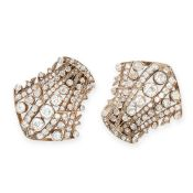 A PAIR OF ANTIQUE DIAMOND CLIP BROOCHES in shield design, set with old cut diamonds all totalling