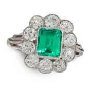 COLOMBIAN EMERALD AND DIAMOND CLUSTER RING set with an emerald cut emerald of 1.55 carats, within