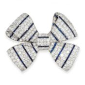ART DECO SAPPHIRE AND DIAMOND BROOCH, 1930S in platinum, designed as a bow, pave-set with circular-