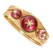 ANTIQUE FOILED QUARTZ AND PEARL BANGLE, 19TH CENTURY in yellow gold, the tapering body set with a