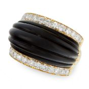 A VINTAGE ONYX AND DIAMOND DRESS RING in 18ct yellow gold, of bombe design, set with a carved and