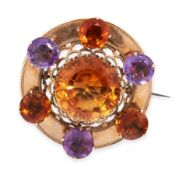 ANTIQUE VICTORIAN SCOTTISH CITRINE AND AMETHYST BROOCH in circular form, set with a central round