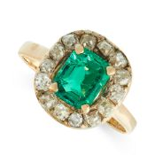 EMERALD AND DIAMOND RING of cluster design, set with a step-cut emerald estimated to weigh