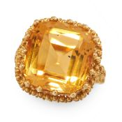 CITRINE DRESS RING comprising of a cushion cut citrine of 8.44 carats in beaded border, with