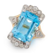 TOPAZ AND DIAMOND RING in 18ct yellow gold, in Art Deco style, set with an emerald cut topaz of 8.36
