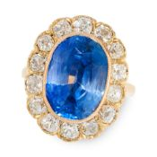 A CEYLON NO HEAT SAPPHIRE AND DIAMOND DRESS RING in 18ct yellow gold, set with a cushion cut blue